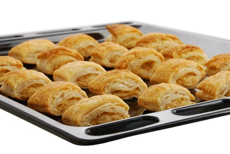 Black baking pan  with fresh baked bourekas aka burek - puff pastry filled with mashed potato photo
