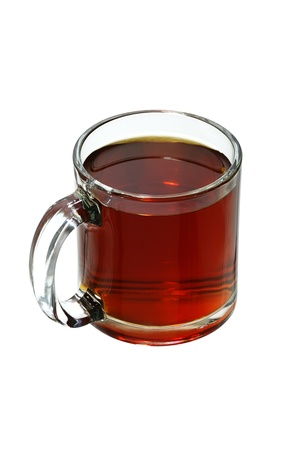 Glass mug full with freshly brewed hot black tea isolated on white background