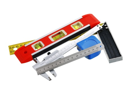 bubble level: Set of measuring tools including rule, tape measure, vernier caliper, bubble level and carpenter square isolated on white background