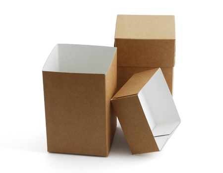 Two simple brown carton boxes on white background with shadow