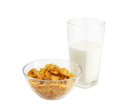 Healthy breakfast including glass of milk and glass bowl of cereal isolated on white background