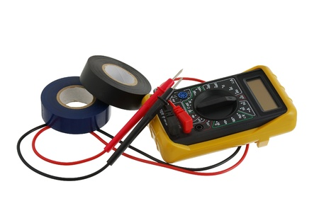 Electricity worker set including two insulating tape rolls and multimeter isolated on white