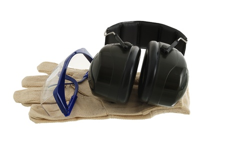 Working protection set including pair of gloves, glasses and anti-noise headphones isolated on white background Stock Photo