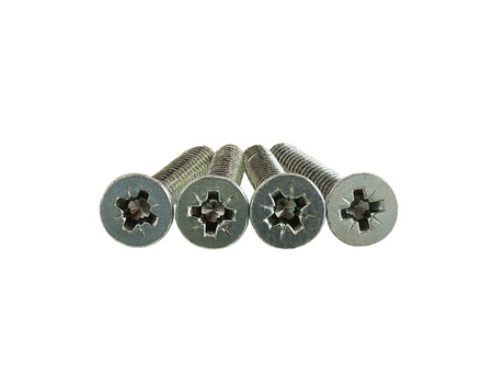 Four screws with flat cross head isolated on white background photo