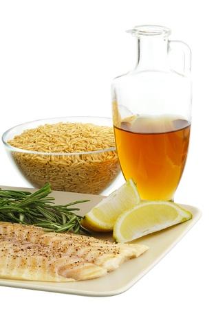 Mediterranean diet dinner ingredients including fresh fish, brown rice, herbs, lemon and olive oil Stock Photo - 10201590