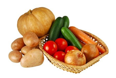 Autumn vegetables mix including onion, carrot, tomatoes, potatoes, cucumbers and pumpkin isolated on white background