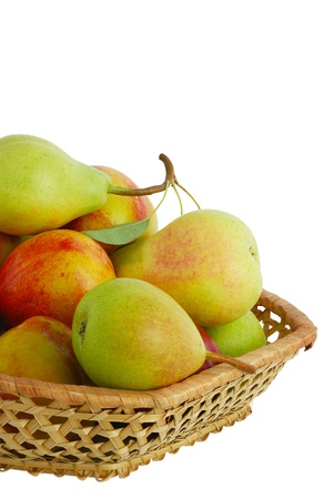 Cropped closeup of fresh pears, peaches and nectarines in interwoven basket isolated on white background
