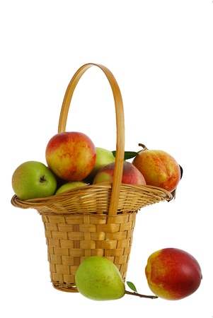 Fresh pears, peaches and nectarines in interwoven basket isolated on white background