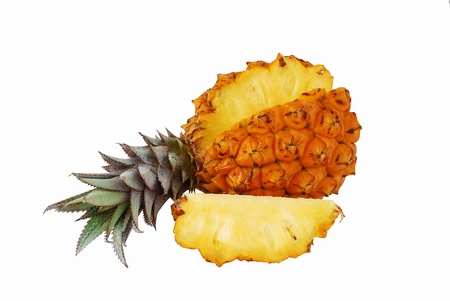 Fresh juicy pineapple with cut off slice isolated on white background