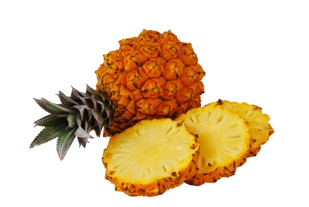Two fresh bright orange pineapples one whole and one sliced isolated on white background