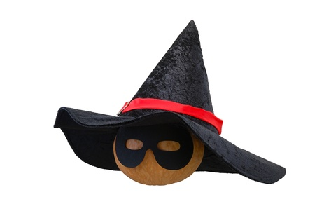 Small Halloween orange pumpkin in black witch hat and  masquerade mask isolated on white background