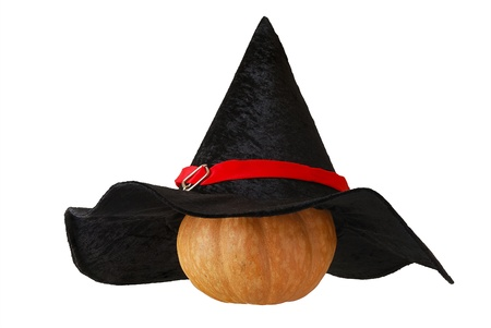 Small Halloween orange pumpkin in black witch hat isolated on white background Stock Photo