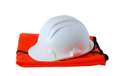 Work safety set including helmet and orange vest isolated on white