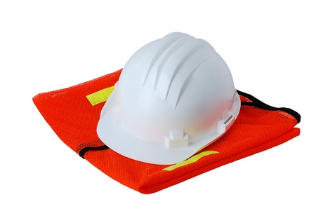 Basic work safety set including helmet and orange vest isolated on white background photo
