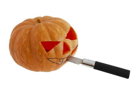 Halloween jack o lantern preparation - carving pumpkin with knife isolated on white background Stock Photo