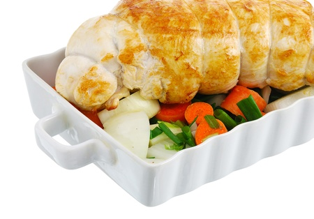 Crop of bound grilled turkey breast with  vegetables on baking pan isolated on white background Stock Photo