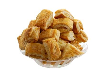 Pile of fresh baked bourekas  aka burek in glass bowl isolated on white background Stock Photo