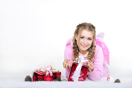 The young beautiful girl an angel with gifts  photo