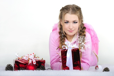 The young beautiful girl an angel with gifts Stock Photo - 11571792