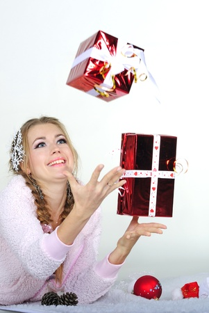 The young beautiful girl an angel with gifts Stock Photo - 11571791