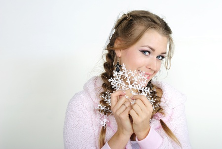 The young beautiful girl with a snowflake in hands photo