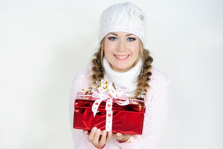 The young beautiful girl an angel with gifts Stock Photo - 11571784