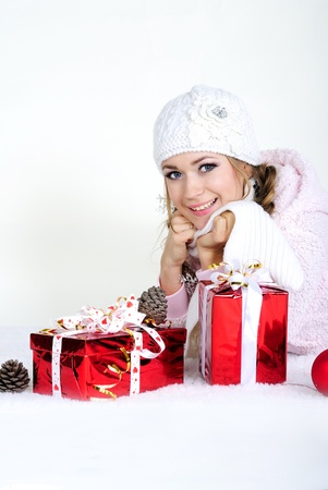 The young beautiful girl an angel with gifts Stock Photo - 11571789