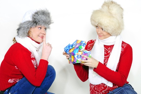 Two young beautiful girls with gifts on a white background Stock Photo - 11571818