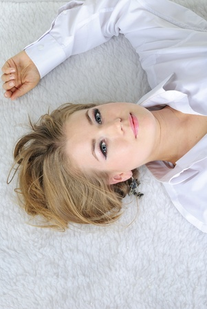 The young beautiful girl lies in a man Stock Photo
