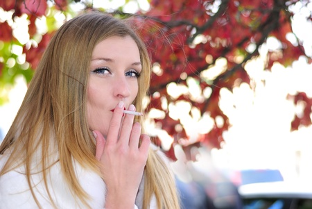 secular: The young beautiful girl with a cigaret