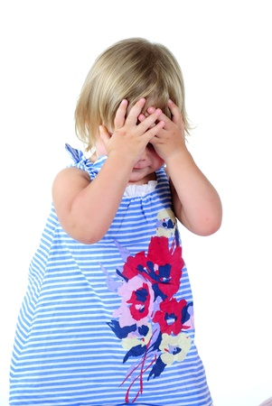 The small beautiful girl has closed eyes hands on a white background