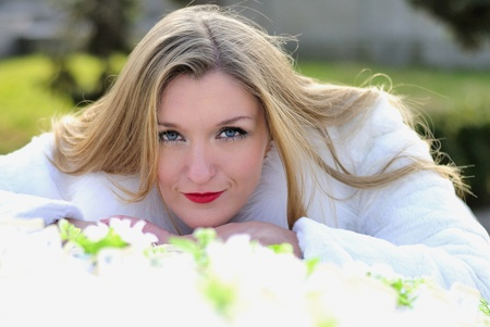 secular: The young beautiful girl in a white fur coat with red lipstick  Stock Photo