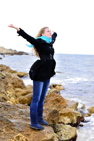 The young beautiful girl near the sea