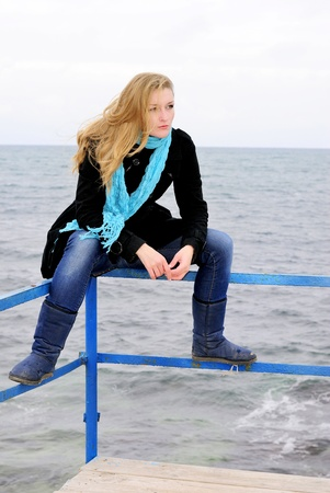 secular: The young beautiful girl near the sea