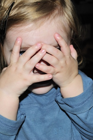 The small beautiful girl has closed eyes hands  Stock Photo