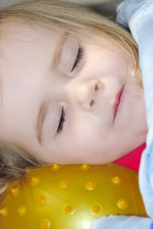 favourite: The small beautiful girl sleeps on a favourite ball  Stock Photo