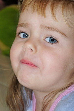 attentiveness: Portrait of the small beautiful girl with a sad face Stock Photo