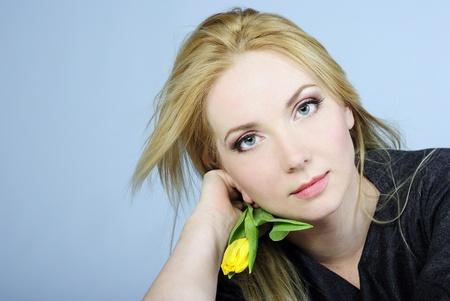 portrait of the young beautiful girl with æåëòûì by tulip Stock Photo