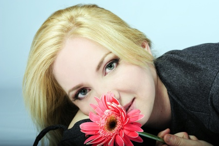 portrait of the young beautiful girl with flower Stock Photo