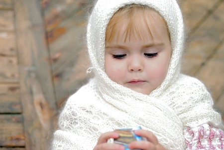 attentiveness: Portrait of the small beautiful girl in a white kerchief Stock Photo