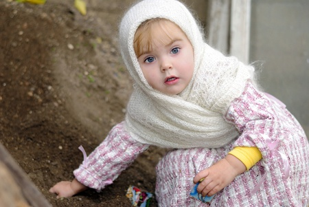 Portrait of the small beautiful girl in a white kerchief Stock Photo - 12361281