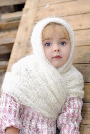 attentiveness: Portrait of the small beautiful girl in a white kerchief Stock Photo