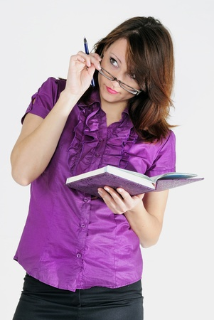 attentiveness: The young beautiful bright girl with the daily log and the handle wearing spectacles
