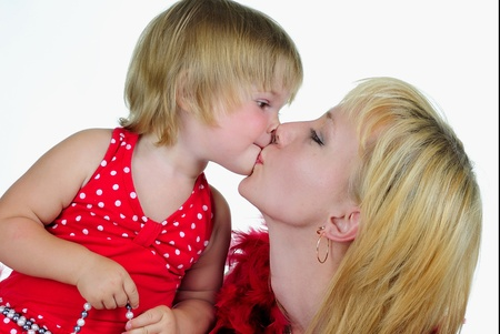 The small beautiful girl plays with mum a white background