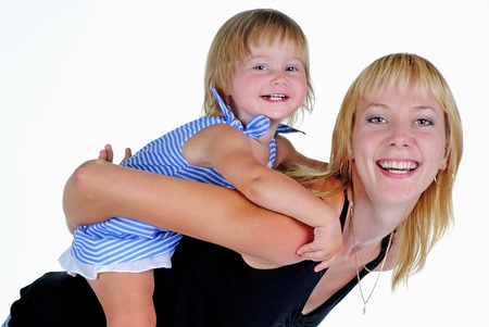 The small beautiful girl plays with mum a white background photo