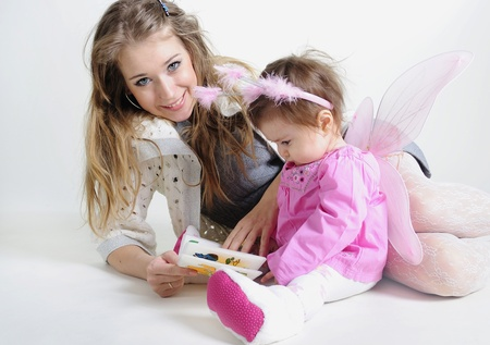 attentiveness: The small beautiful girl at mum on hands on a white background with wings