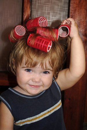 small beautiful girl with curlers