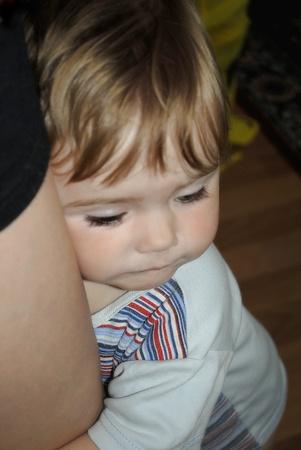 small beautiful girl embraces ma for leg