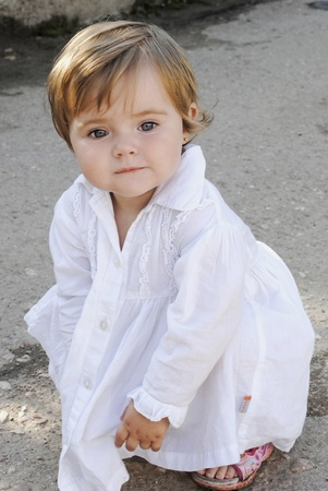 small beautiful girl in white gown