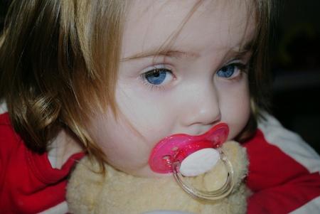 cogitations: small beautiful girl with nipple and plush bear  Stock Photo